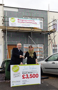 Photograph of the scaffolding banner and promotional cheque