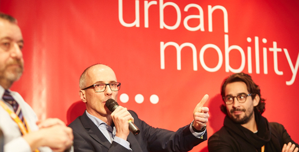 Image of City Car Summit branded stage backdrop with speakers in discussion